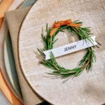 Rosemary wreath place card up close on a plate.