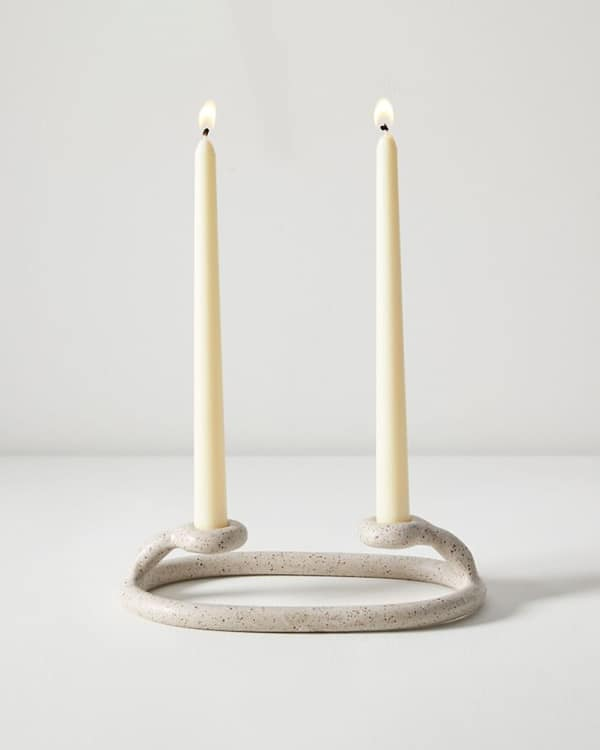 Due candlestick on a white background.