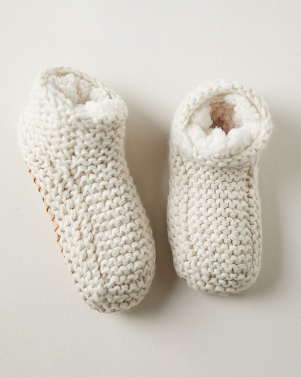 Cozy slippers on a warm colored surface.