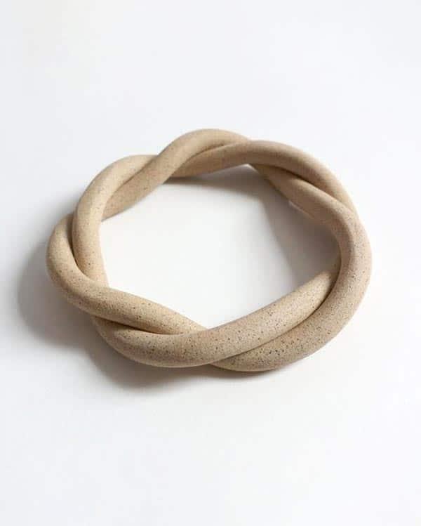 A ceramic trivet by virginia sin.