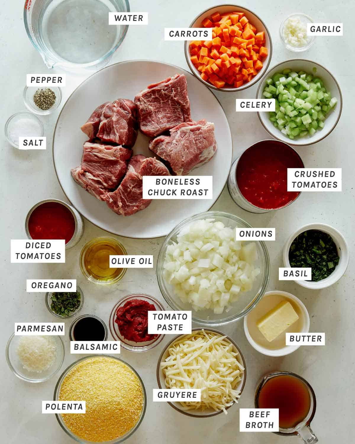 Ingredients in beef ragu all laid out on a kitchen counter.