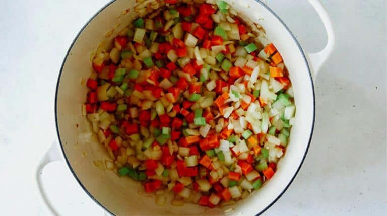 Sauted vegetables in a stock pot.