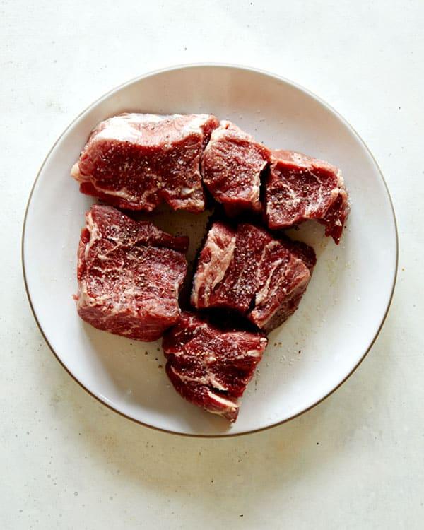 Seasoned chuck beef on a plate.