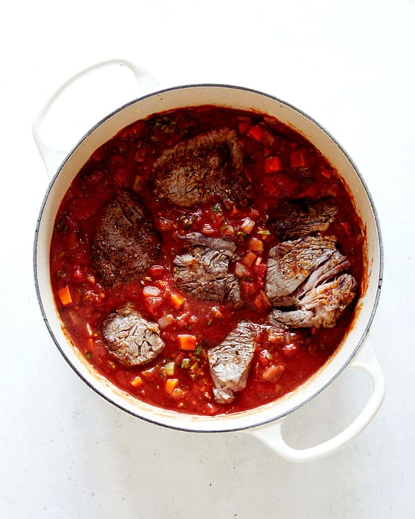 Beef in tomato sauce in a stock pot.