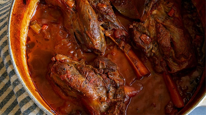 Braised lamb shanks in a dutch oven.