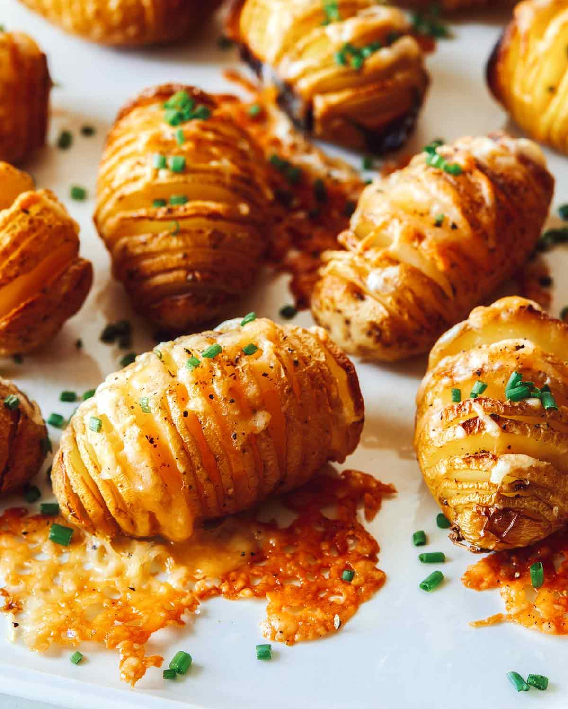 Close up on hasselback potatoes on a platter.