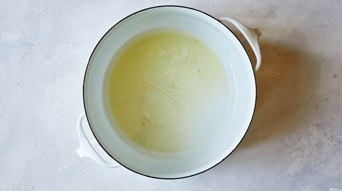 A pot of melted butter to make a chicken and dumplings recipe.