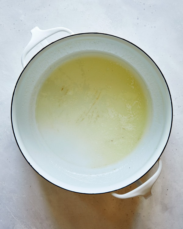 A pot of melted butter to make a the start of a soup recipe.