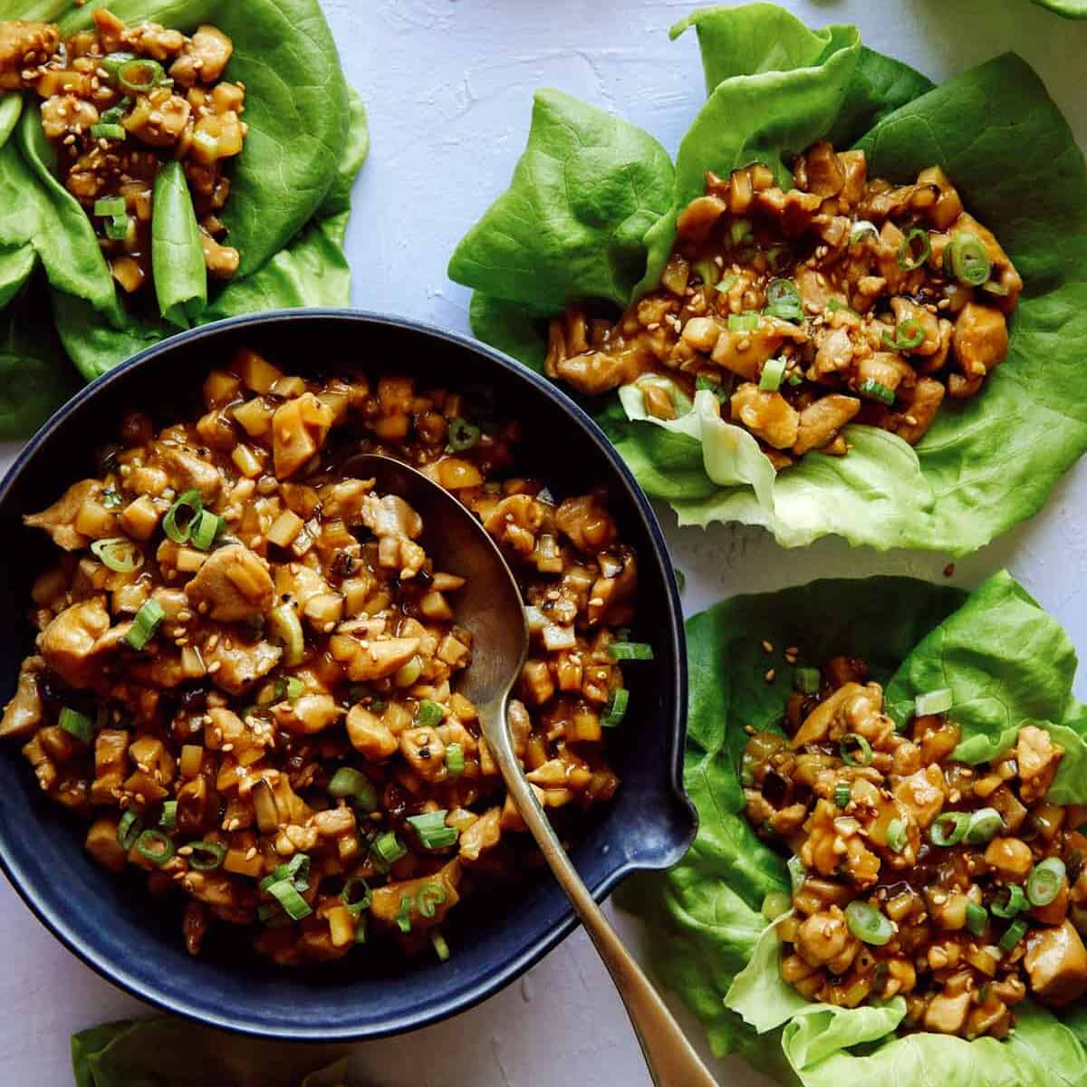 Chicken lettuce wraps with lettuce cups full of the chicken mixture, a healthy dinner idea.