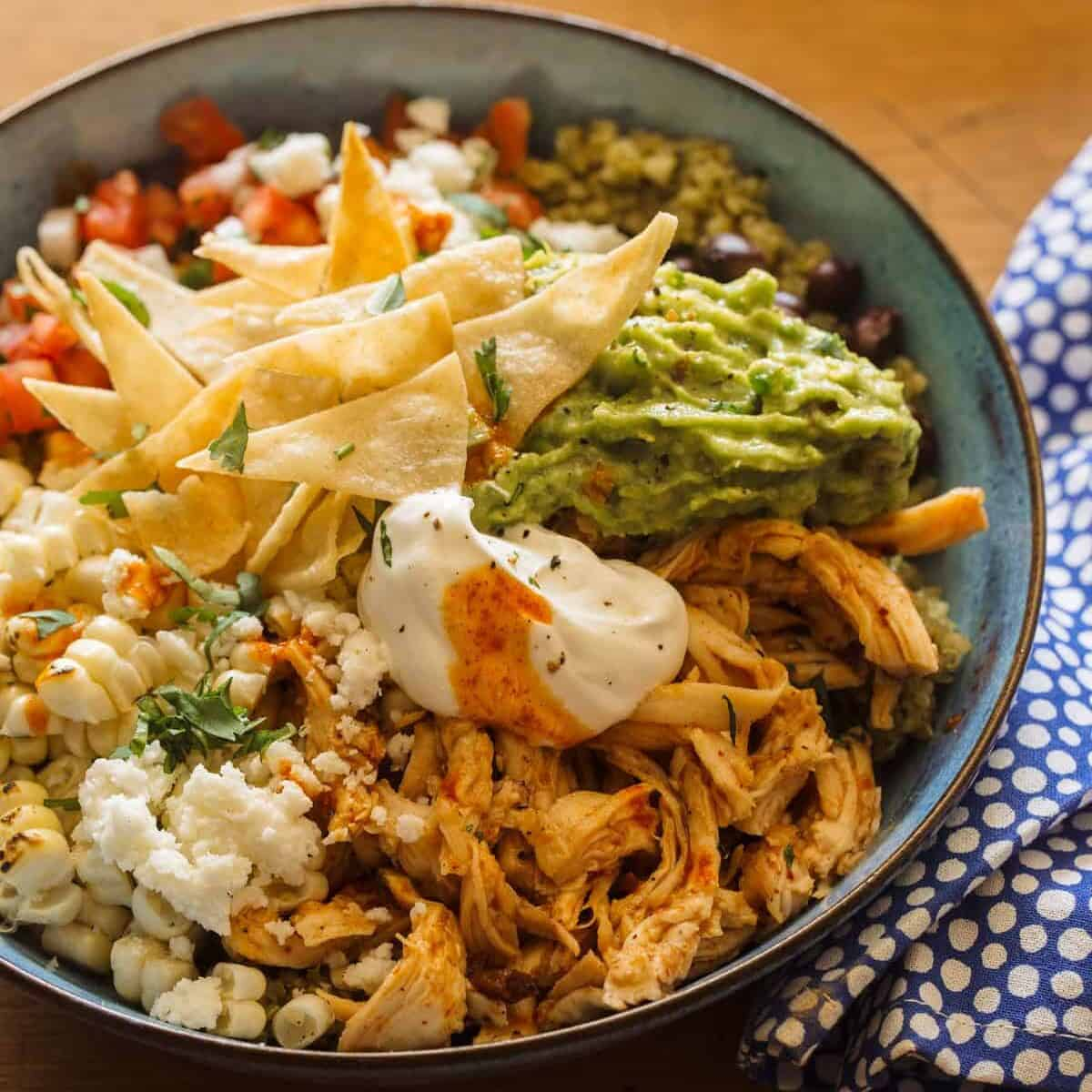 A close up of a honey chipotle chicken burrito bowl, a heathy dinner recipe.
