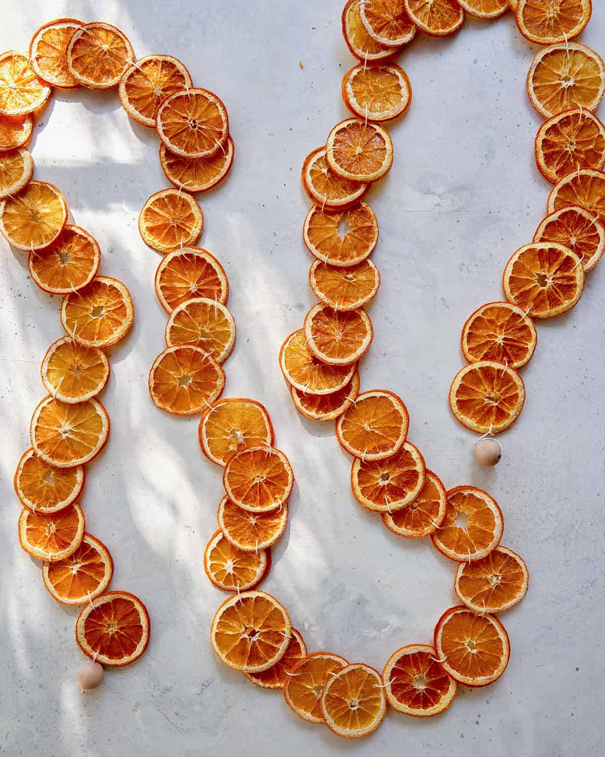 A dehydrated citrus garland laid out on a table.