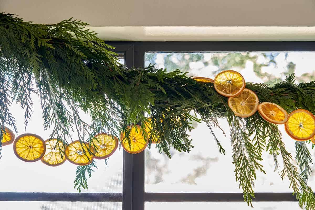 Citrus garland strung above a kitchen window.