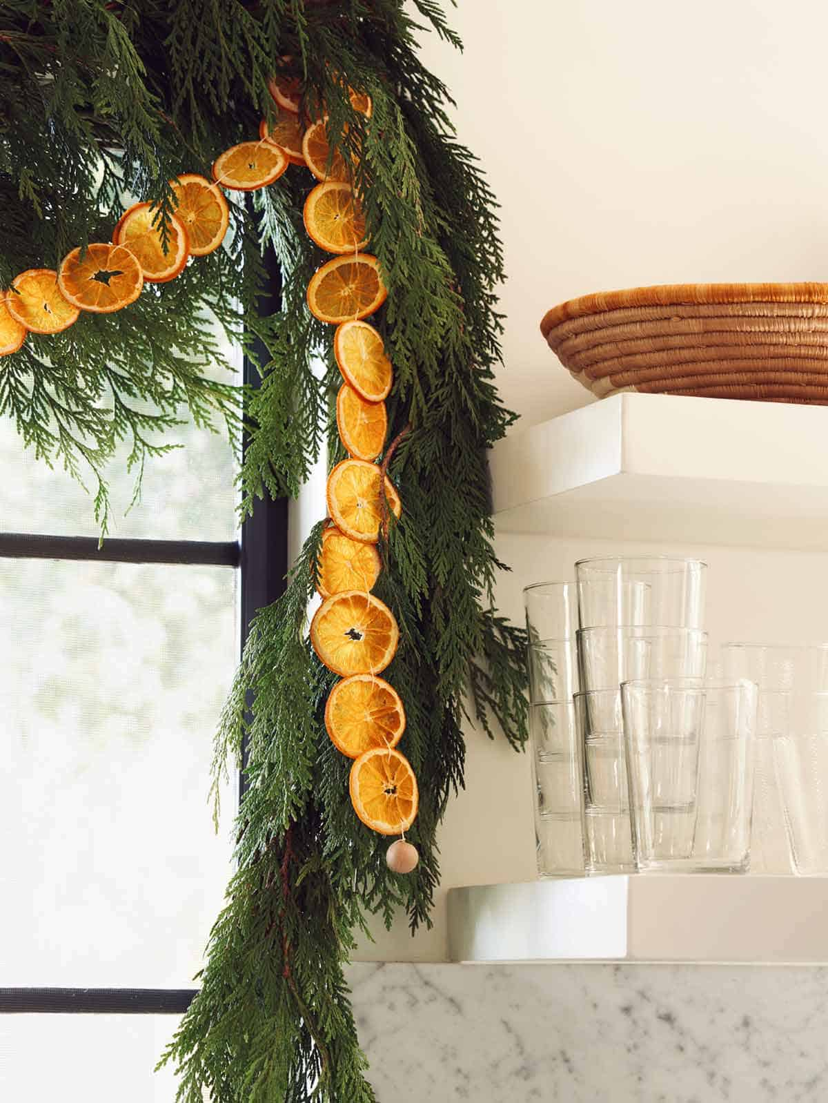 Close up on a dehydrated citrus garland in a kitchen.
