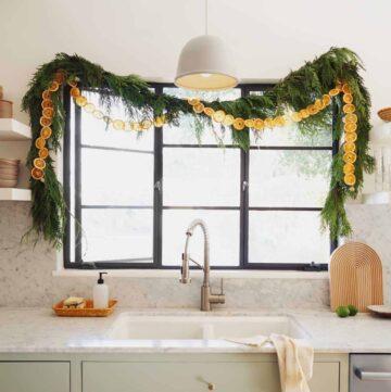 Dehydrated citrus garland strung up in a kitchen window.