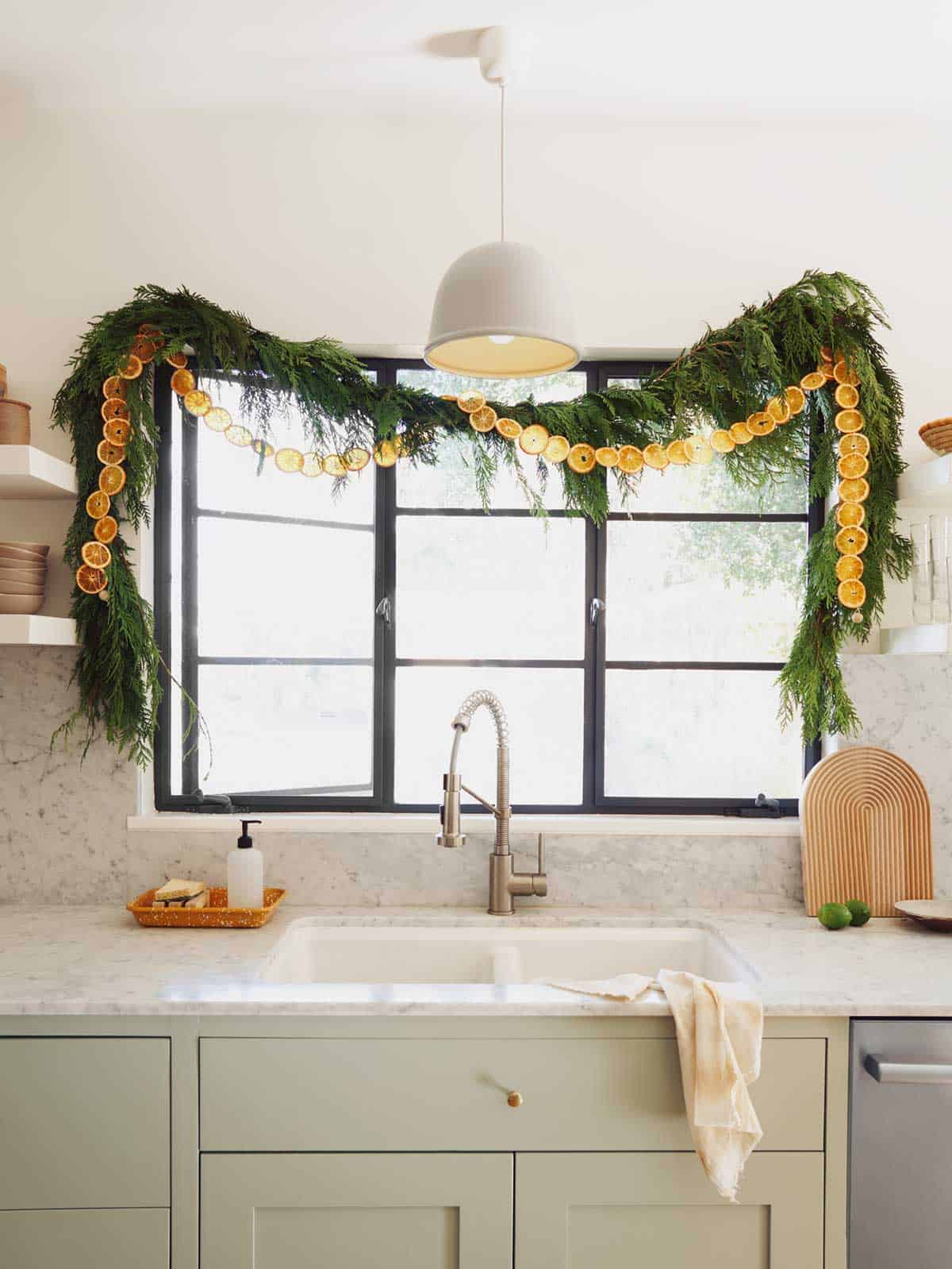 Dehydrated citrus garland above a kitchen sink.