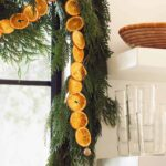 Dehydrated citrus garland strung up in a kitchen window.