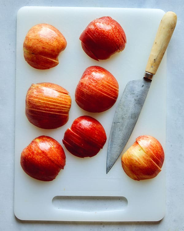 Thinly slice apples for german apple cake.