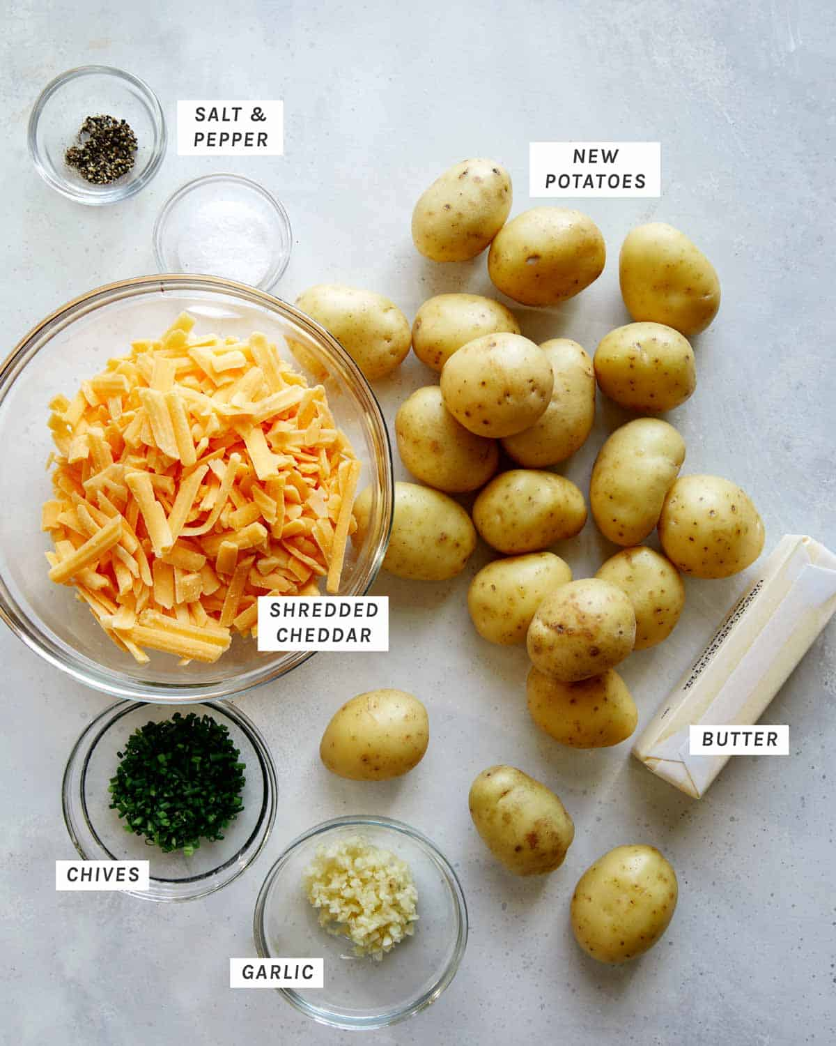 Ingredients to make hasselback potatoes all laid out on a kitchen counter.