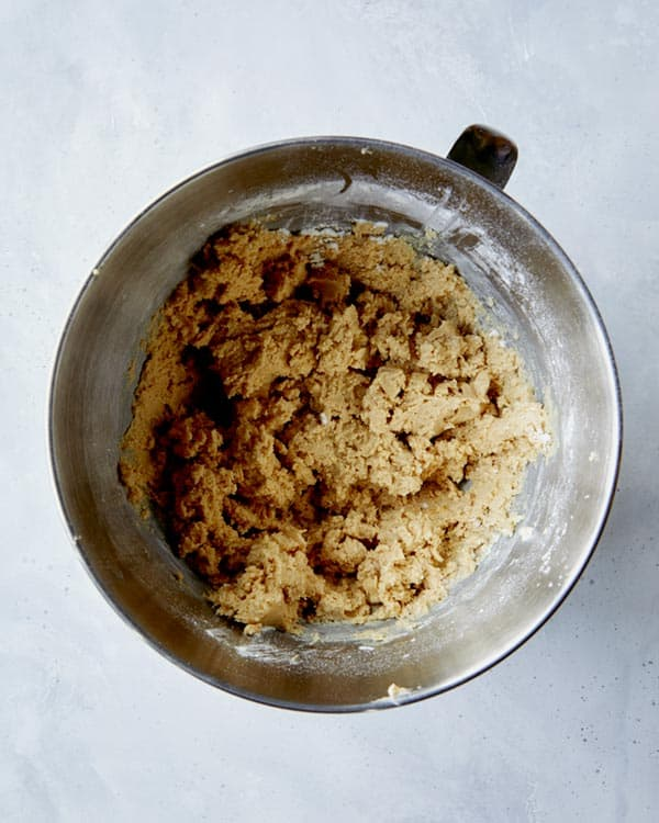 The dough for kitchen sink cookies in a stand mixer bowl.