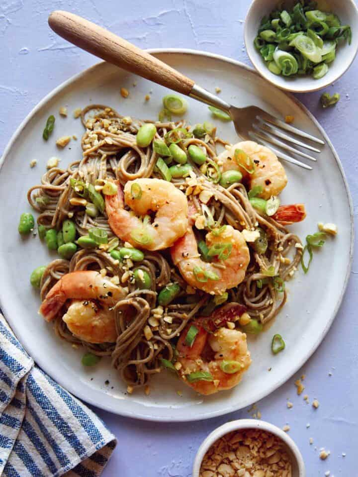 One plate of shrimp soba noodles with a fork, a healthy dinner idea.