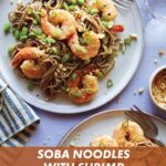 Soba noodles with shrimp on two plates with forks and garnish next to it.