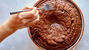 Poking sticky toffee pudding with a fork.