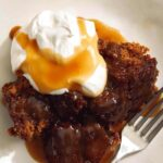 Sticky Toffee pudding recipe in two plates with a fork.