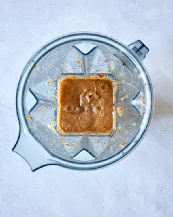 Dates pureed in a blender for sticky toffee pudding.