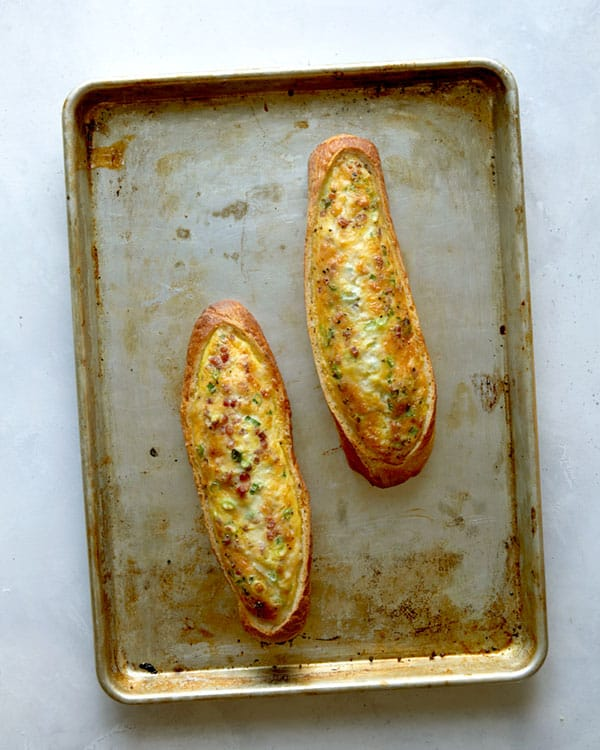 Baked egg boats on a baking sheet.