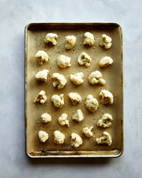 Cauliflower florets baked on a baking sheet.