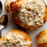 Close up on a bread bowl with clam chowder.