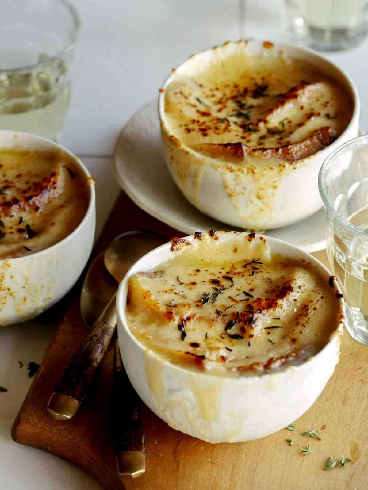 French Onion soup recipe in three bowls.