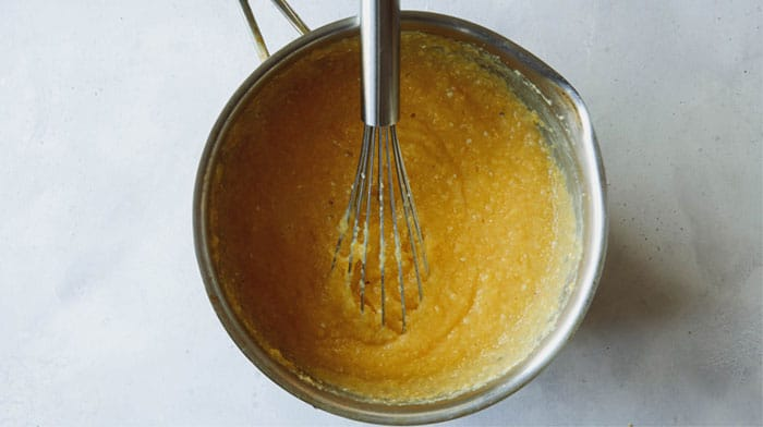 Cooked polenta in a skillet.