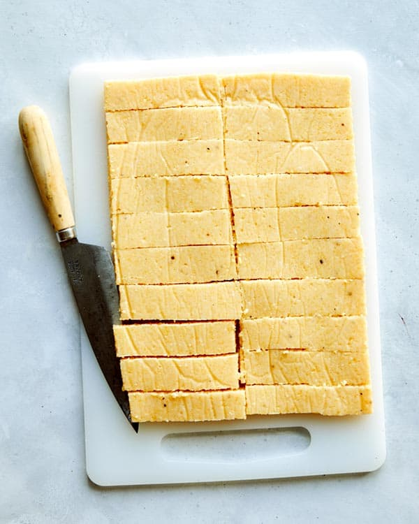 A slab of polenta cut up into french fries.