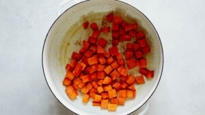 Sweet potato chunks cooking in a stock pot.