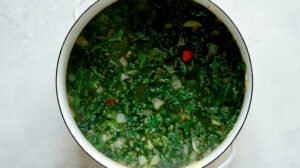 Tortellini soup in a stock pot simmering.