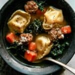 Close up on one bowl of tortellini soup.