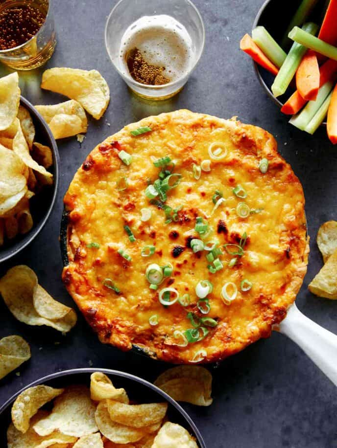 Buffalo Chicken Dip in a skillet with green onions on top.