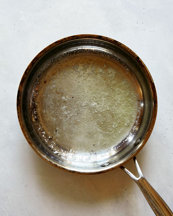 Melted butter in a skillet.