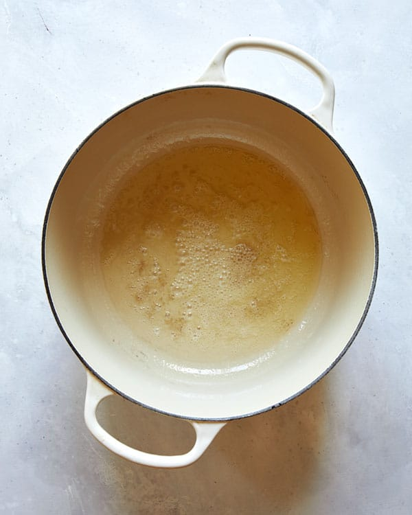Melted butter in a stock pot.