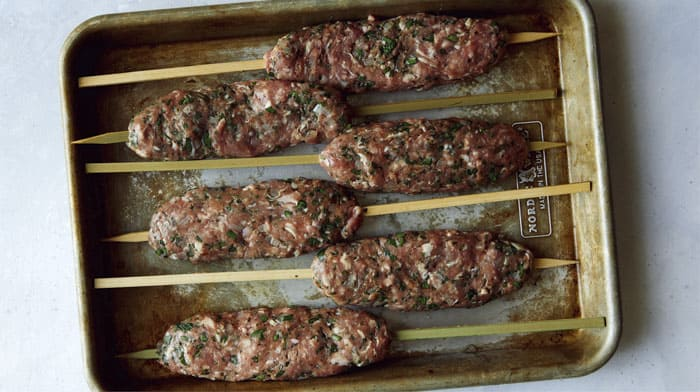 Lamb Kofta on a skewers ready to be grilled.