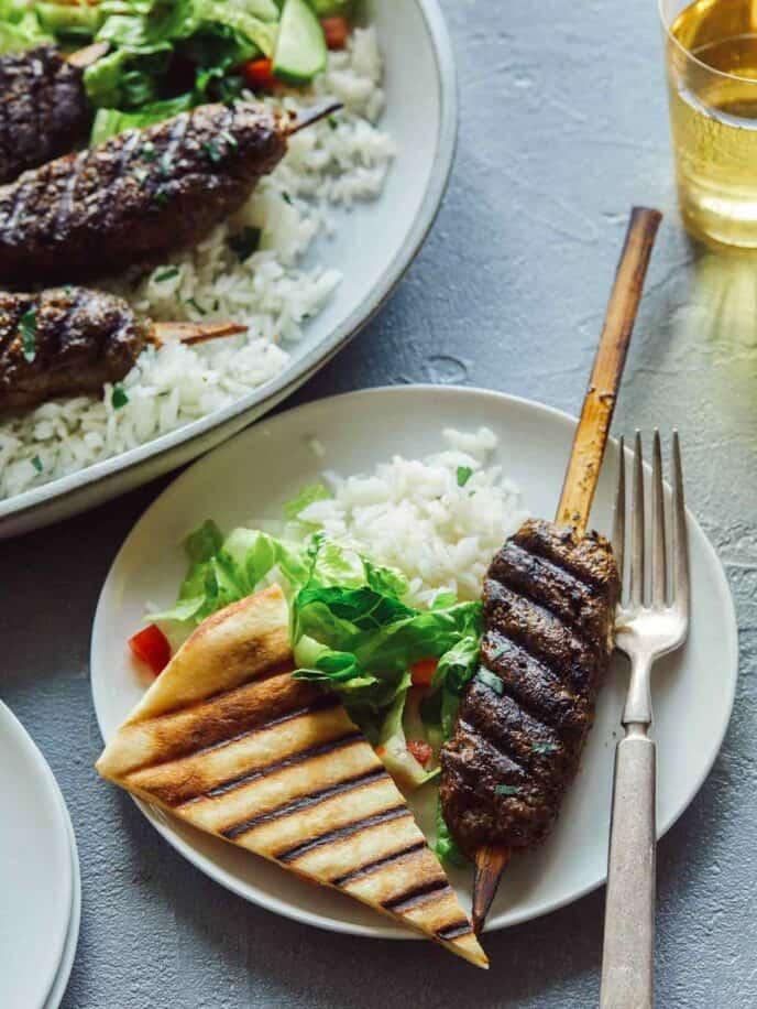 Lamb kofta recipe on a plate with rice and pita.
