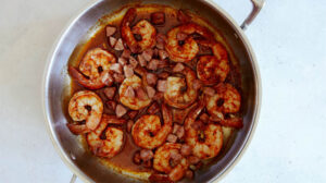 Shrimp and sausage in a skillet for shrimp and grits.