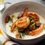 Close up on Shrimp and Grits in a bowl.