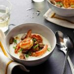 Two bowls filled with shrimp and grits recipe.