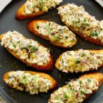 Smoked Trout on crostini on a plate.