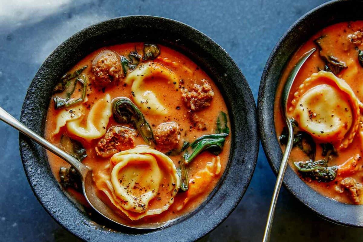 Creamy Tortellini Soup Recipe in a bowl with a spoon in it.