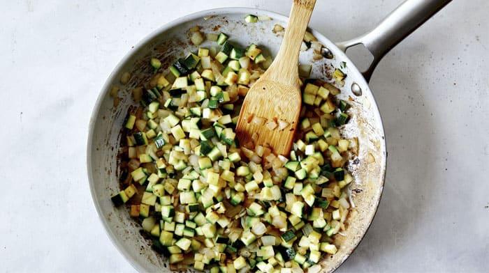 Zucchini, onions, and garlic in a skillet to make Jajangmyeon.