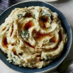 A recipe for Brown butter Colcannon in a bowl.
