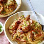 Two bowls of cajun shrimp pasta.